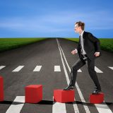 bigstock-businessman-walking-up-on-the-63056110
